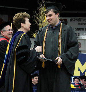 Chancellor Person congratulates Robert Burack at the 2013 Spring Commencement ceremony.