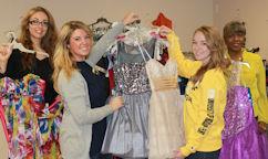 Ashley Minaudo, Aleesha Mathis, and Paulina Tylus sort dress with shop owner Walethia Aquil