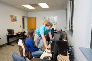 Students working in the UM-Flint Georgraphic Information Systems (GIS) Center