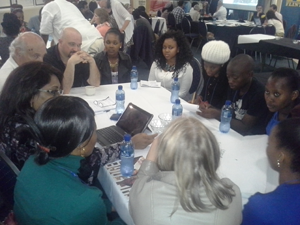 UM-Flint and Durban University of Technology students brainstorm collaborative project ideas.