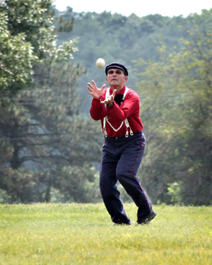 Vintage base ball players do not use gloves.