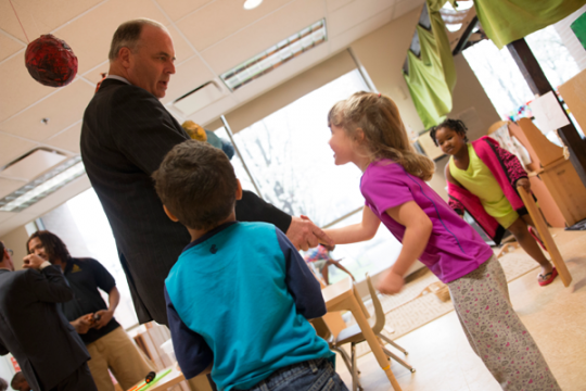 Congressman Kildee shakes hands with students at the Early Childhood Development Center