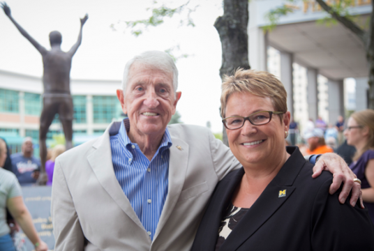 Bobby Crim and UM-Flint Chancellor Susan Borrego after unveiling of his statue and scholarship donation