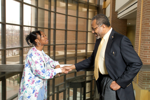 Dean Gordon talks with a student in UM-Flint's William S. White building