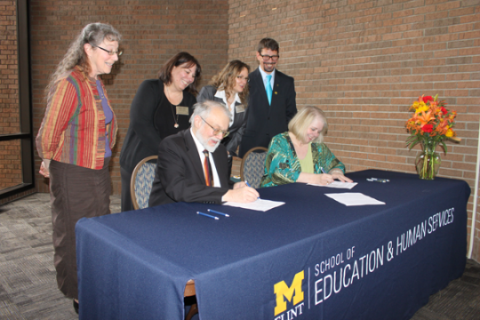 UM-Flint and Mott Community College sign new early childhood education agreement
