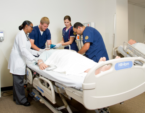 UM-Flint nursing students and instructors in simulation lab