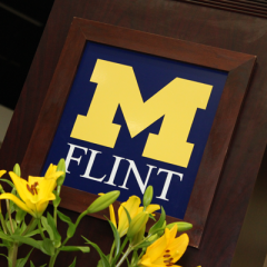 UM-Flint logo adorns commencement podium