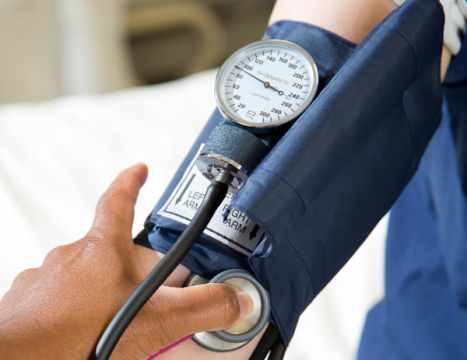 Close-up of taking a patient's blood pressure.