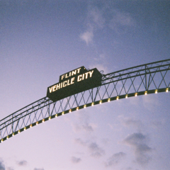 "Photo of ""Flint Vehicle City"" arches at dusk."