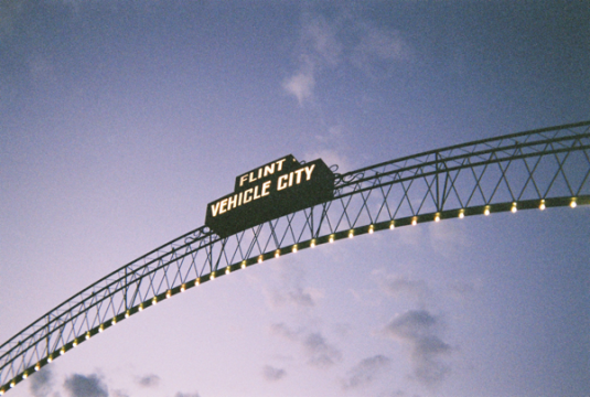 "Photo of ""Flint Vehicle City"" arches at dusk."