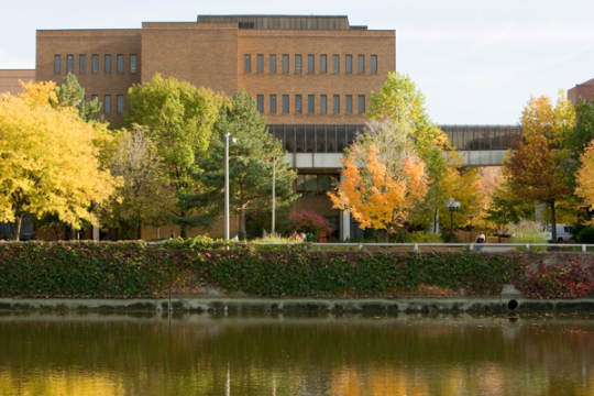 UM-Flint campus and the Flint River in autumn.