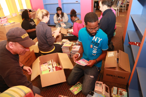 UM-Flint students, staff, and faculty sort books at the Whaley Children's Center.