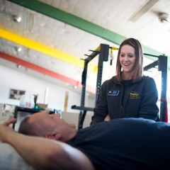 UM-Flint physical therapy students Alyssa Brennan and Kelsey Blegen treat Jim Schultz at PT Heart.