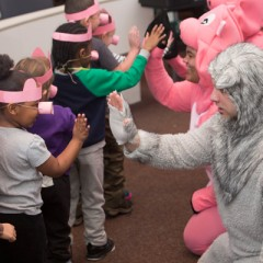 Interacting with students after their debut performance at UM-Flint's Early Childhood Development Center.