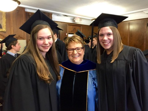 UM-Flint students Rebecca DeJonge (Biology) and Elena Sobrino (Anthropology and Music) with Chancellor Susan E. Borrego at University of Michigan Honors Convocation.
