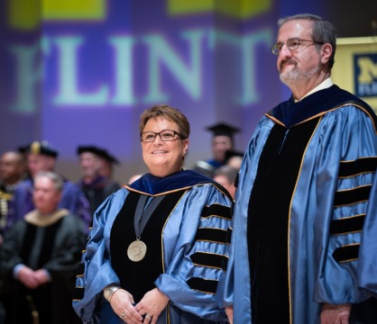 UM-Flint Chancellor Susan E. Borrego and U-M President Mark Schlissel.