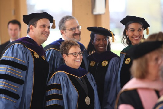 Regents Michael Behm, Katherine White, and Shauna Ryder Diggs with U-M President Mark Schlissel and UM-Flint Chancellor Susan E. Borrego.