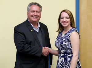 School of Management Dean Scott Johnson congratulates Ashley Knific on winning the business plan competition.