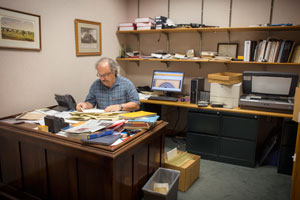 Archivist Paul Gifford in his office in the Frances Willson Thompson Library.