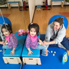 Dr. Susannah Steele, PT, DPT, PCS, works with a child at the Pediatric Rehabilitation Center-Commonwealth in Ann Arbor.