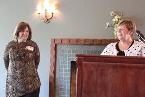 University Registrar Karen Arnould recognizes Associate Registrar Rhonda Banks for 40 years of service.