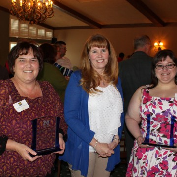 Suzanne Shivnen (left) and Monique Wilhelm (right) were presented with Staff Recognition Awards by Staff Council chair Sandy Alberto (center).