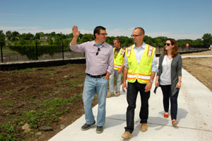 Ryan Londrigan takes staff members from UM-Flint's Office of Development & Alumni Relations on a tour of Chevy Commons.