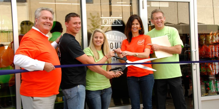 SOM Dean Scott Johnson, students Sean Tabor and Jennifer Wenzlick, and SkyPoint Ventures' Jocelyn and Phil Hagerman at the opening Ground Floor Market in downtown Flint.