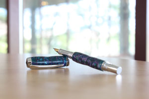 One of Hooper's handcrafted acrylic pens, available through his business Scholarly Pens.