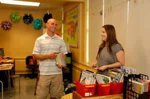 Student teachers partner with mentor teachers to run classrooms and prepare curriculum.