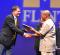 Provost Douglas Knerr presents award to Africana Studies professor Ernest Emenyonu