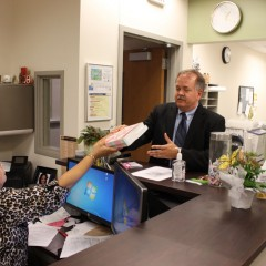 Dr. Wrobel picks up book donations from Lynn Barbee in the Mathematics Department.