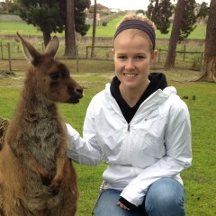 Kayla Bailey with a wallaby in Australia.