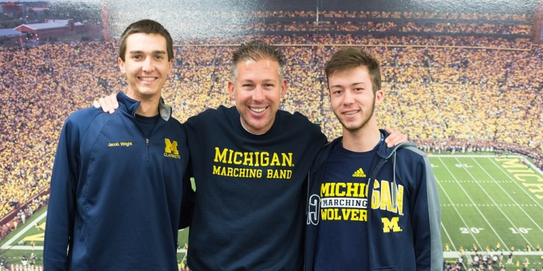 UM-Flint student Jacob Wright, Michigan Marching Band director John Pasquale and UM-Flint student Luther Houle at a recent band rehearsal, (L to R).