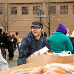 UM-Flint student volunteer at last year's giveaway.