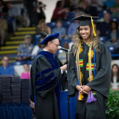Proud UM-Flint graduate receiving her degree.