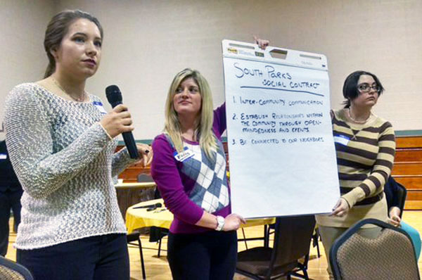 UM-Flint secondary education students share research with South Park Neighborhood residents.