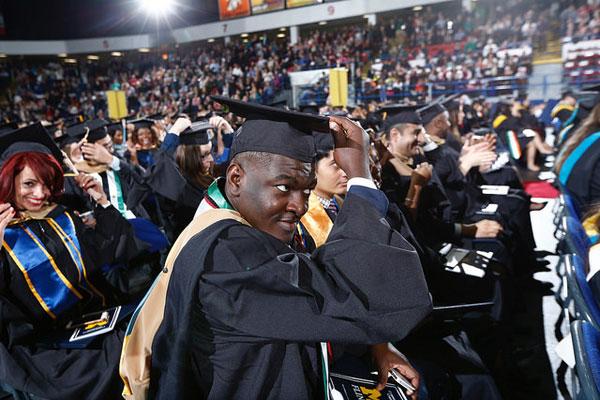 New UM-Flint graduates turn their tassels to the left.