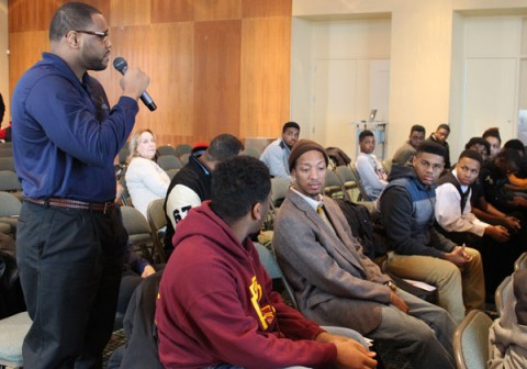 Joe Austin, UM-Flint Star Program student, addresses attendees during a discussion about personal characteristics that shape self-identity and future success.