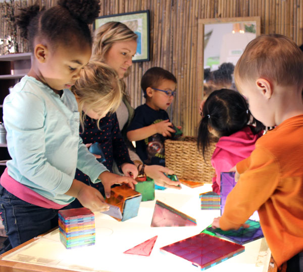 Light tables at the Early Childhood Development Center spark excitement among the children.