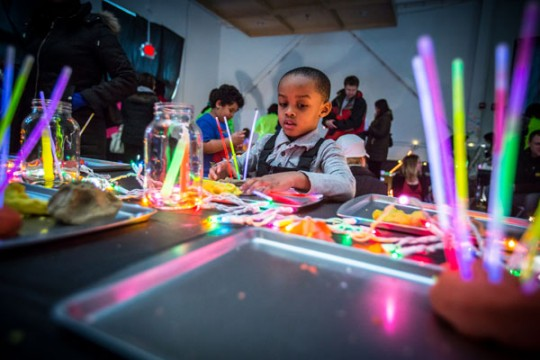 Kids playing with glow sticks at the 2015 Light Up the Night event.