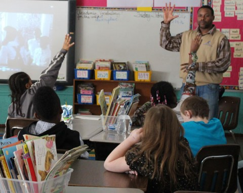 "STAR Program Coordinator Richard Russell questions kids about historical events in ""The Watson Go to Birmingham-1963."""