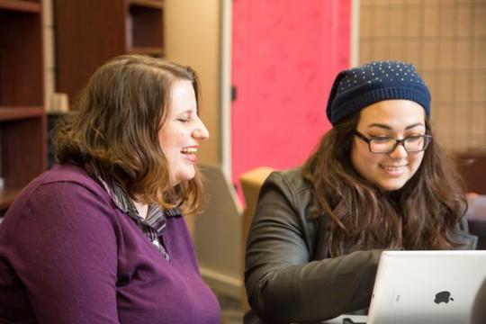 UM-Flint's Ellen Bommarito LGBT Center director talks with a student.