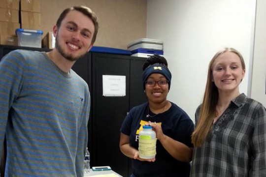 UM-Flint students assist the Red Cross during Flint water crisis.
