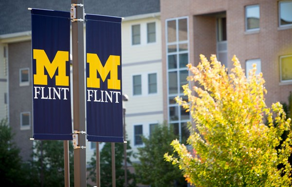 UM-Flint banners in front of First Street Residence Hall.