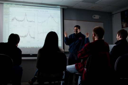 UM-Flint physics professor Rajib Ganguly, PhD discusses super-massive black holes with students.