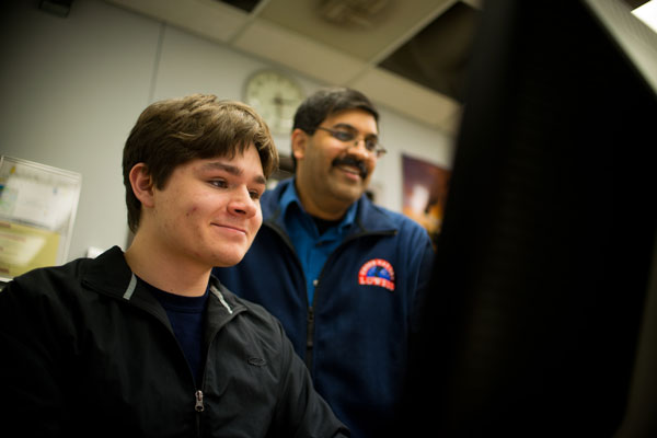 Rajib Ganguly, PhD working with physics and math major Justin Wisby.