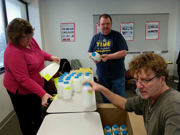 UM-Flint communication and visual arts professor Anthony McGill (center) helped coordinate student volunteers.