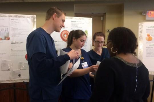 UM-Flint nursing students providing educational materials.