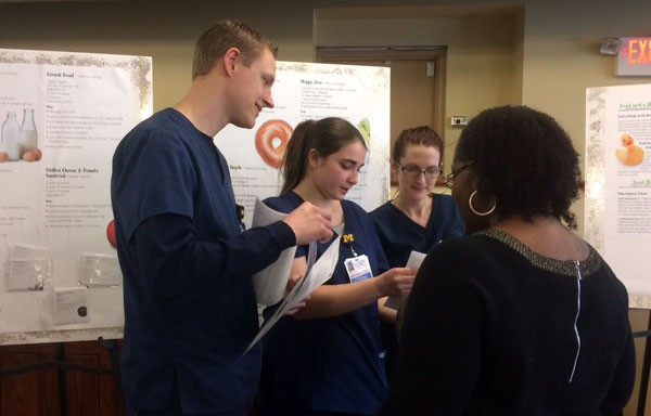 UM-Flint nursing students providing educational materials.